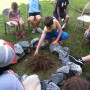 group of kids makeing camp fire