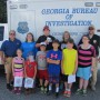 group of kids with GA Bureau of Investigations