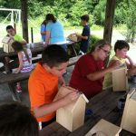 group of kids makeing birdhouses